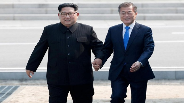 Two Koreas mark Moon-Kim summit anniversary
