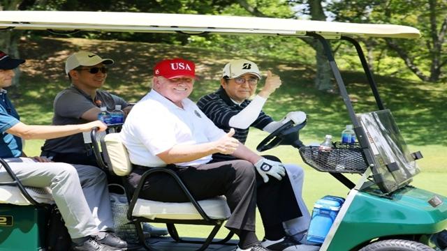 Trump downplays North Korea launches on Japan visit
